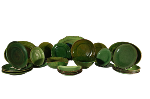 Collection of Twenty-Five Provencal Green Glazed Pottery Plates and Platters