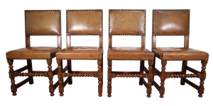 Four Oak and Leather Upholstered Dining Chairs