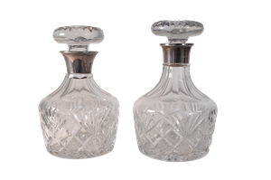Two Silver Collared Cut Glass Decanters