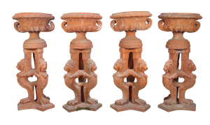 Four Classical Teracotta Urns on Tripod Column Stands featuring Tryptich Lions