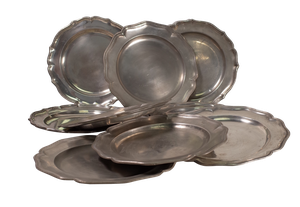 Eight Scallop Edged Pewter Plates