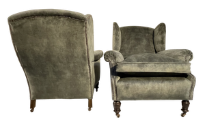 Pair of Victorian Studded Velvet Upholstered Wingback Armchairs Raised on Round Turned Front Legs and Outswept Square Back Legs