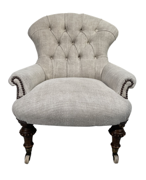 Early Victorian Button Back Armchair on Turned Mahogany Legs Upholstered in Antique French Hemp Linen