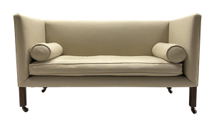 Edwardian Square Back Upholstered Settee with Two Bolster Cushions Raised on Square Mahogany Legs with Castors
