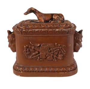 Stoneware Tobacco Jar decorated with Oriental Heads and a Recumbent Greyhound to Lid