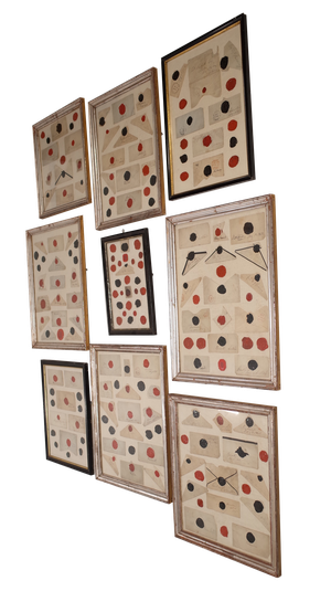 Collection of Nine Framed Wax Seals Mounted on Antique Linen in Antique Ebonised and Silver Gilt Frames