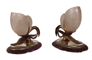 Pair of Glass Nautilus Shells Mounted and Decorated with Gilt Metal Leaves and Straps on Oval Velvet Mirrored Bases