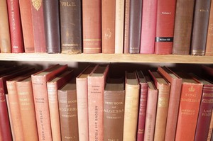 Selection of an Oxford University Academic's Library in Various Shades of Red